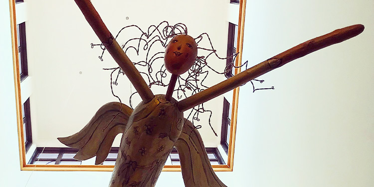 Hanging wooden angel sculpture