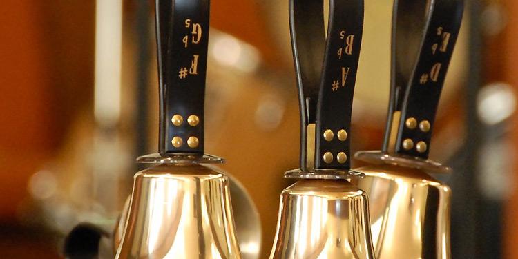 Closeup of three handbells