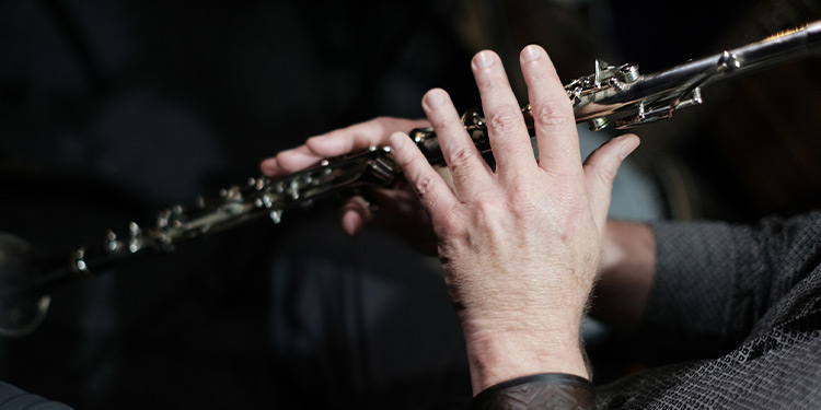 Closeup of man playing a clarinet