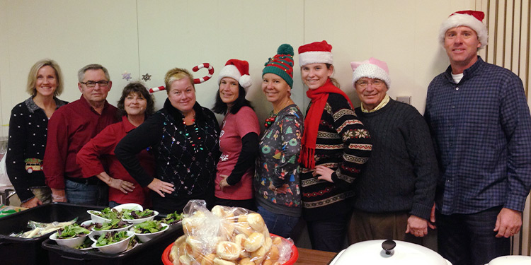 Team support Homeless & Hungry poses for a photo at Christmas time