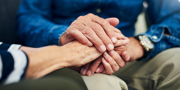 Closeup of woman and man holding hands