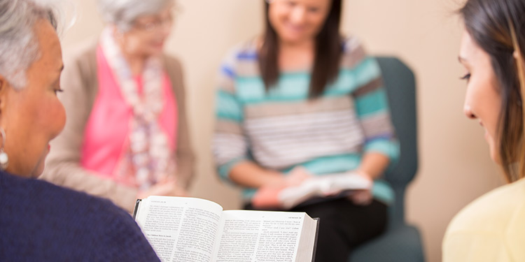 Group of women study the bible together